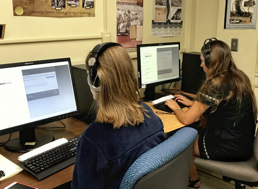 Right: Claire Hitter, Left: Piper Brown-Kingsley working on cataloging oral histories at the Wisconsin Historical Society