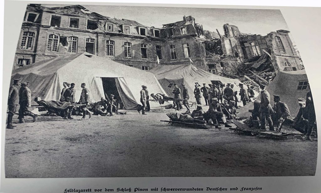 Field hospital in front of the Pinon Palace with severely wounded Germans and Frenchmen.